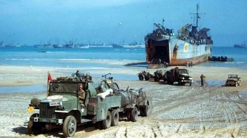 Unloading vehicles and supplies from an LST (landing ship, tank) at Normandy beachhead, summer 1944.