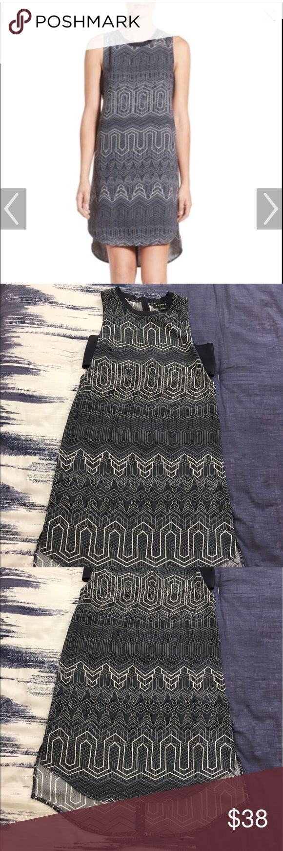 Trouve chevron print dress Trouble chevron print dress from Nordstrom.  Worn twice and in like new condition.  Colors are navy/gray/ivory.  I typically wear a size 0 or 2 and had to go with an XXS in this.  Slight high/low hemline. Trouve Dresses