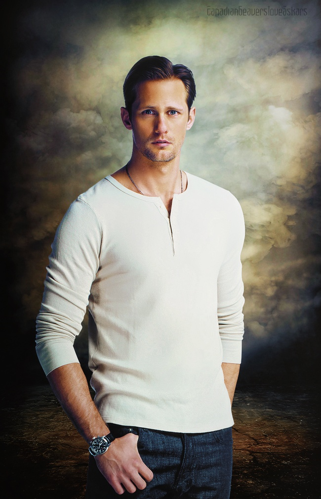 Alexander Skarsgard portrait wearing jeans and an off-white pullover shirt