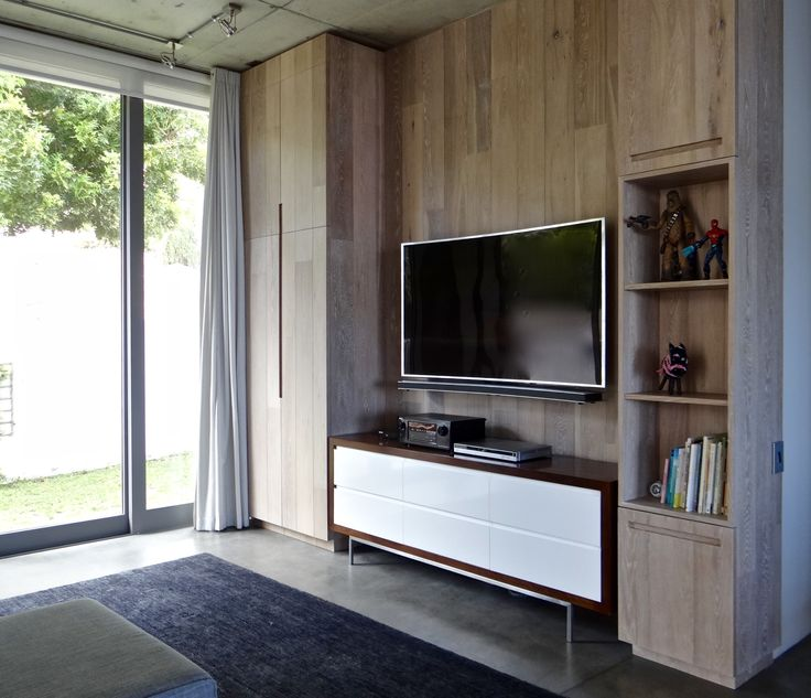 Timber clad TV wall and cabinets to Family room. Private Residence. Cape  Town