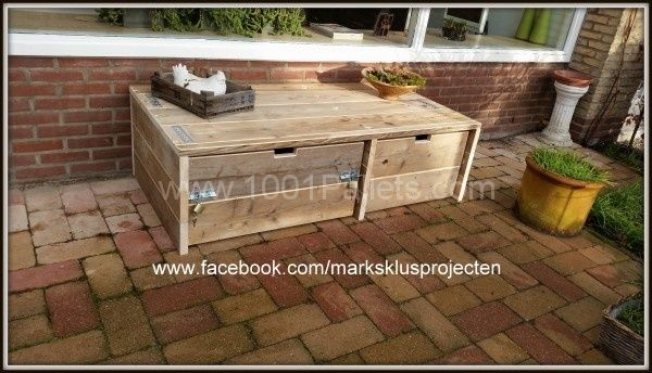 Storage cabinet made of recycled scaffolding wood and pallet wood. Can also be used as a small lounge sofa w/storage.