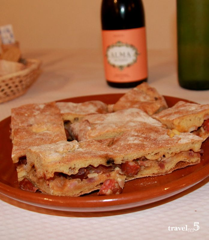 Traditional Galician empanada cooked on wood fire oven at Casa do Patron, Lalin Galicia Spain food - travelto5.com