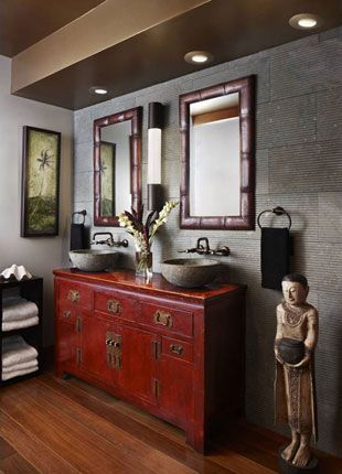 Red Chinese sideboard repurposed as bathroom vanity cabinet