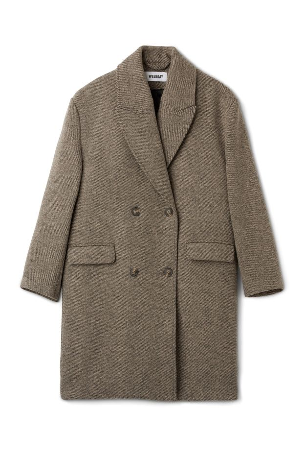 The Michelle Coat is a wardrobe essential in the chilly season. This classic coat made from a thick wool blend has a straight silhouette, a high stand collar with wide lapels and two flap pockets.- The model is 178 cm tall and wears size small, that measures 114 cm in chest circumference, 95 cm in length and 57 cm in sleeve length.