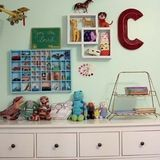 Boys' Names: Cooper and Campbell Ages: 7 and 3.5Location: Atlanta, GARoom Size: 155 sq. ft. Danielle started with a very small room so she knew she was going to have to be efficient with the space. She also knew that she didn't want a typical boys' room with tacky transportation themes or cartoon characters. Instead, she wanted something whimsical and colorful for her boys that they could really love and enjoy. She started with a few vintage finds from thrift stores, antique malls, and…