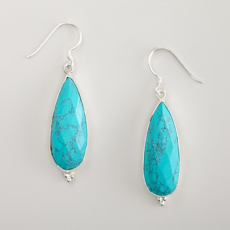 Our naturally bold pair of Turquoise Long Drop Earrings has a unique look that adds to any style. Handcrafted of silver metal with a dramatic faceted façade, these turquoise earrings are a... More Details