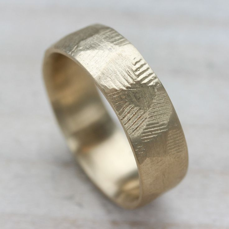 New 7mm Men's & Women's Faceted Wedding Band in 10k yellow gold, 14k rose gold, 14k white gold, 14k yellow gold, 18k white gold, 18k yellow gold, and 950 palladium | Aide-mémoire Jewelry