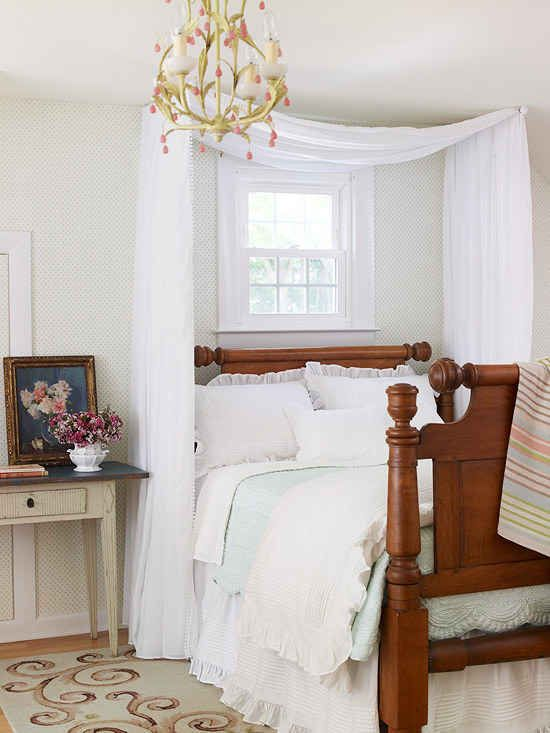 Make your room extra cozy with two mini curtain rods and some cheap fabric.