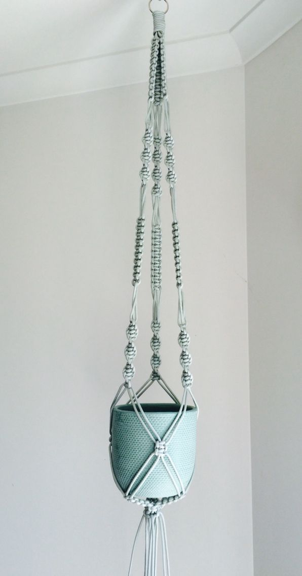 Silver macrame hanger by the planter pod.