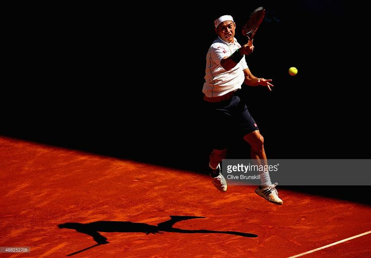 Kei Nishikori of Japan plays a forehand against Ivan Dodig of Croatia in their first round match during day three of the Mutua Madrid Open tennis tournament at the Caja Magica on May 5, 2014 in Madrid, Spain.