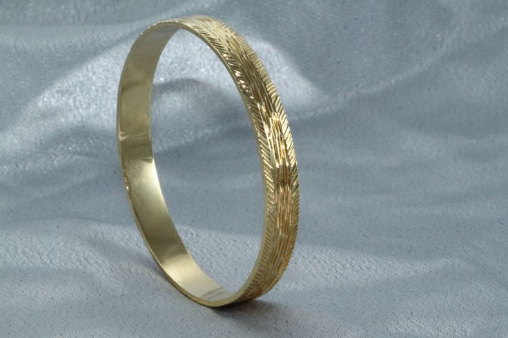 A personal favorite from my Etsy shop https://www.etsy.com/il-en/listing/256427180/gold-bangle-solid-gold-bangles-14k-gold