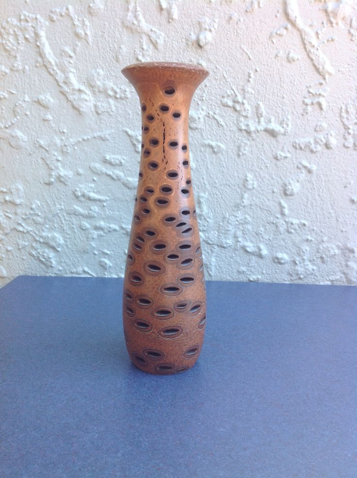 Banksia nut vase. The holes are home to lots of spiders and insects so it's quite exciting when the lathe is first started and they get flung out.