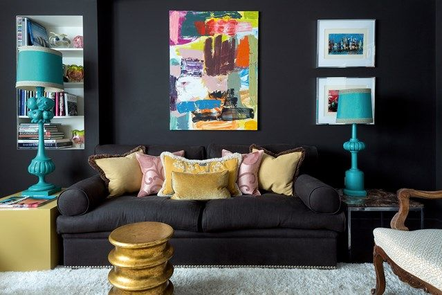 Living room with black sofa and walls. See all our stylish living room design ideas on HOUSE by House & Garden, including this basement TV room with flashes of colour.