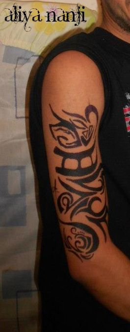 Tattooed arm with black henna