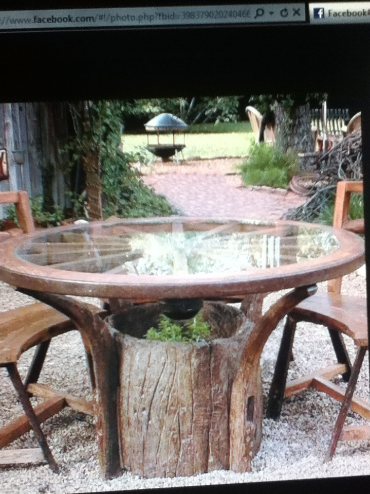 Use an old wagon wheel as a new table