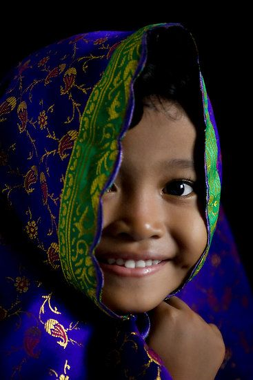 "Smile by Harjono Djoyobisono A happy girl taken at the Idul Adha celebration, December 2007, using available natural light. Location: Solo, Central Java, Indonesia. (via ""Smile"" by Harjono Djoyobisono 