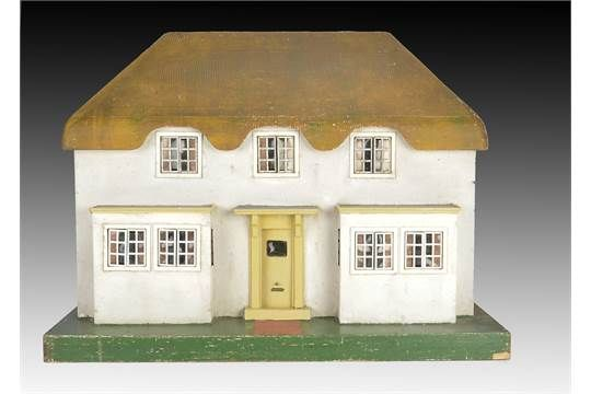 A Tri-ang No.1 Princess dolls' house 1930s, with carved wooden 'thatched' roof, pebble dashed wal