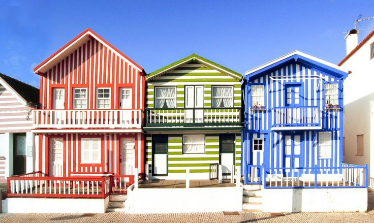 Candy colored beach houses in Aveiro | 19 Places You Can't Miss in Portugal | The best cities, beaches, islands and towns to visit in the beautiful country of Portugal,