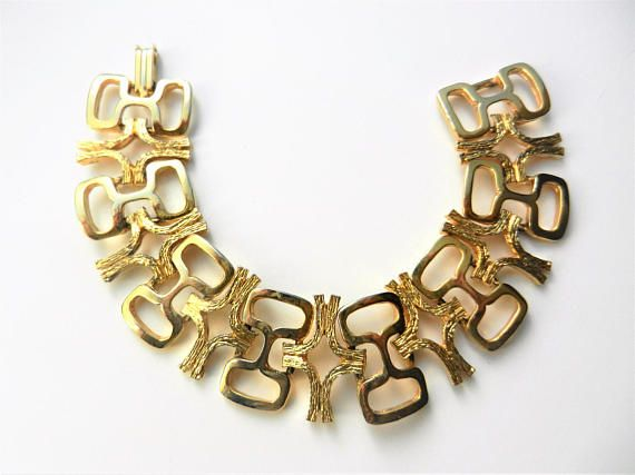 Fanciful Open gold Links glossy finish and nuggets Bracelet