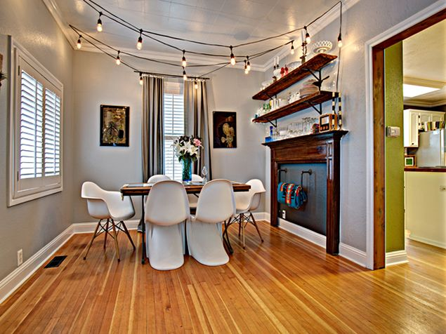 mid-century modern dining room, faux fireplace, indoor string lights, wrightformichele Wright ...