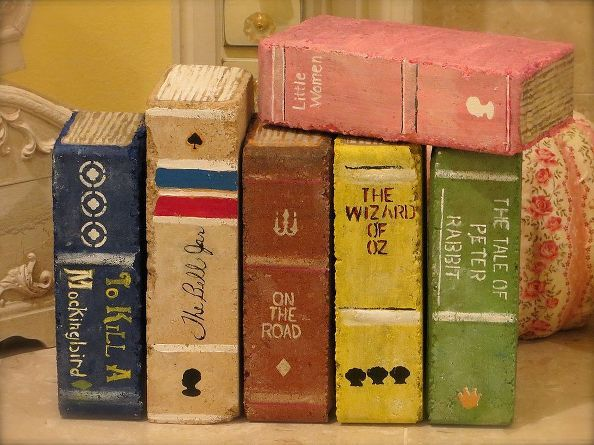 painted brick books, crafts, painting, Used just ordinary bricks Found this one taller filler brick I have seen them with bricks with holes but I had these Looked at pics of old books for ideas Painted gold or brown lines for the pages
