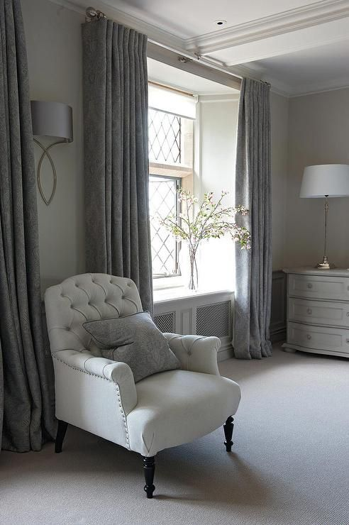 gray french bedroom features a white tufted chair lined. Black Bedroom Furniture Sets. Home Design Ideas