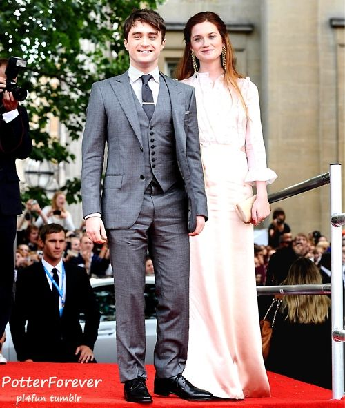 Daniel Radcliffe and Bonnie Wright... they look like what Harry and Ginny  would look like on their wedding day. SOMEBODY PHOTOSHOP SOME GLASSES ON THAT BOY.