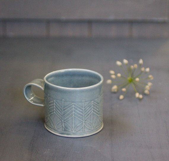 This is the mug you will have to drink your morning coffee with! Dark blue coffee mug in a great size for coffee lovers, adorned with geometric pattern in modern design. This modern tea cup for your evening herbal tea. Perfect for a cozy snuggle on the couch or in bed with espresso or