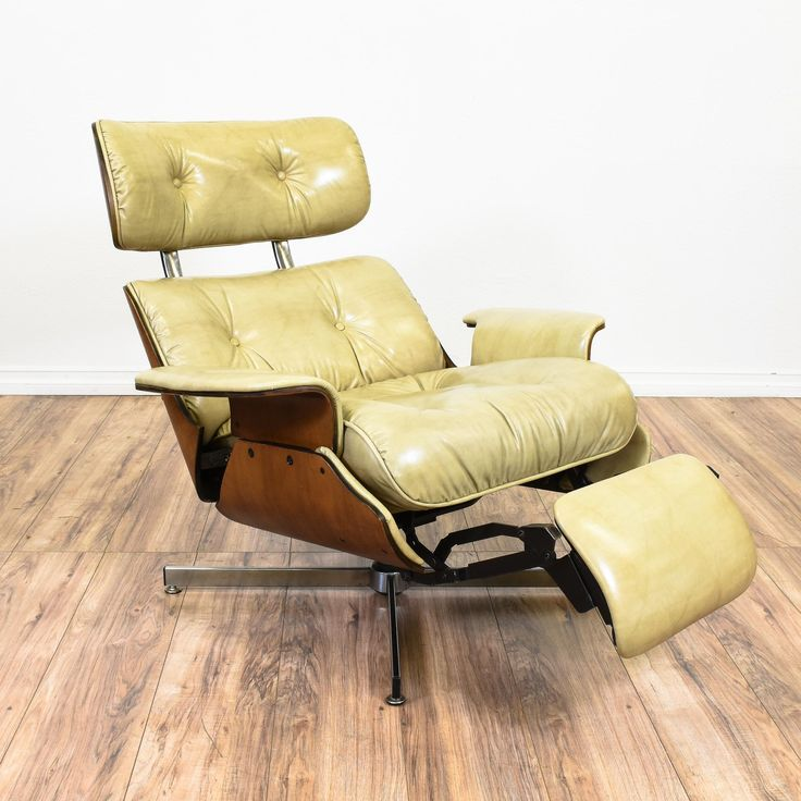 "This ""Plycraft"" recliner armchair inspired by the iconic Eames lounge chair is features a molded plywood shell with a glossy finish. This mid century modern accent chair is upholstered in a durable original off white leather with tufting, a metal base and a unique pop up footrest. Rare and unique piece perfect for lounging in style! #midcenturymodern #chairs #recliner #sandiegovintage #vintagefurniture"