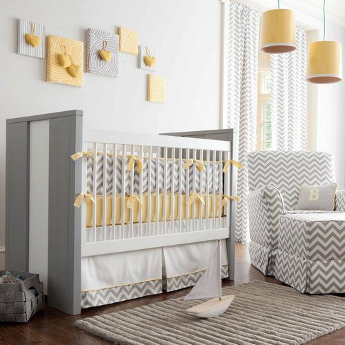 Carousel designs - yellow and gray chevron nursery bedding.