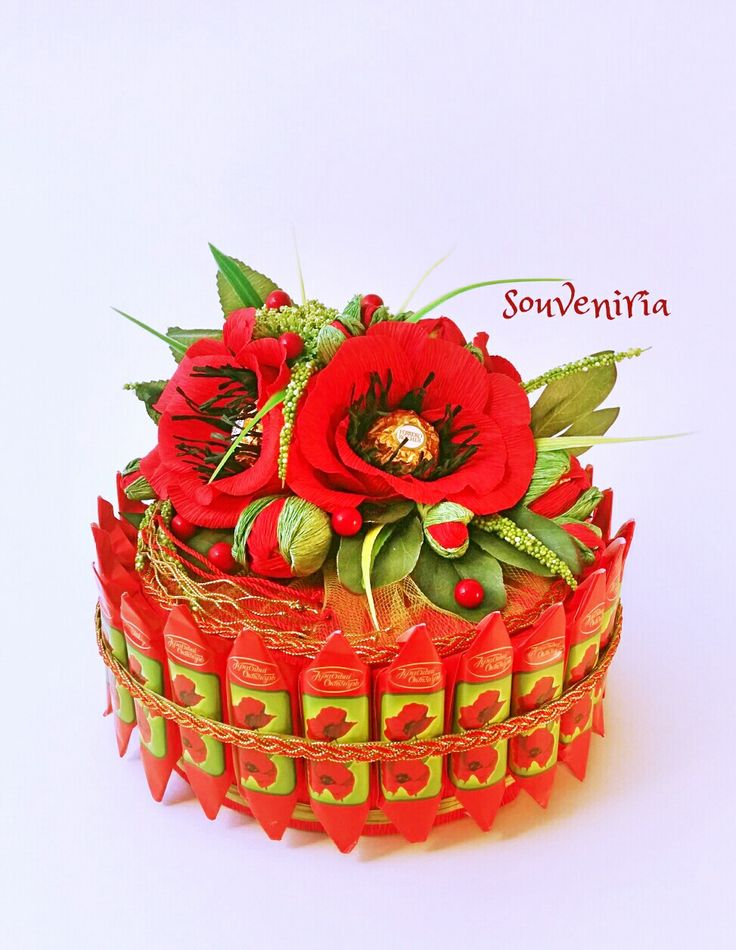 Beautiful composition made of favourite sweets in a shape of a cake is…