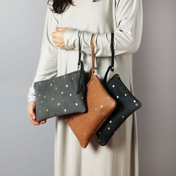 Cute leather clutch with gold confetti dots. Made of buttery soft, natural leather from Italy.  Unlined.  Zipper closure.    Available colors:  -
