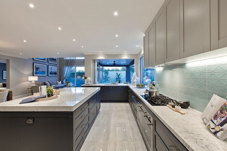 Spacious open plan kitchen in Classic Hamptons World of Style on display in the Astor Grange.