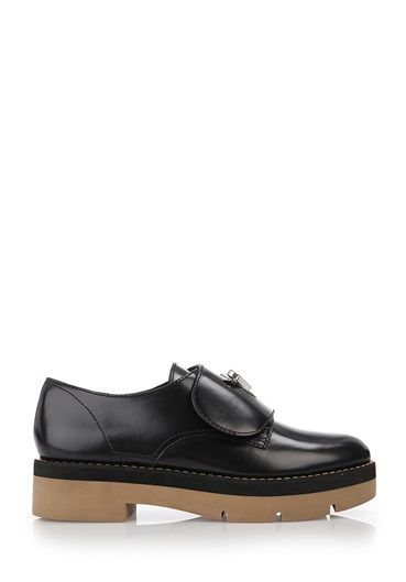 Black leather 'Dillion' oxfords from Alexander Wang featuring foldover top with twist-lock closure, a round toe and a platform sole.