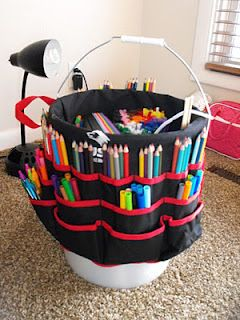 Portable Craft Caddy : use a portable tool belt that drapes over a bucket to hold art or crafting supplies.