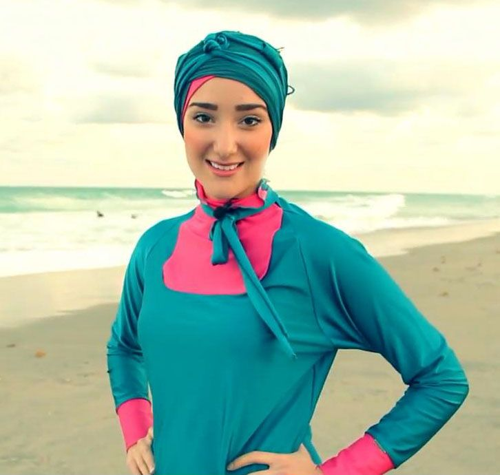 YazTheSpaz89 wearing her Turquoise Teal MADAMME BK burkini at Miami beach!  Have you ordered your limited edition yet? Shop online at www.madammebk.com Only a few pieces left!  #burkini #burqini #modestswimsuit #muslimswimsuit #yazthespaz #miamibeach #paris #burqini #muslimswimsuit #modestswimsuit