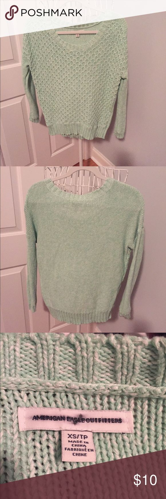 American Eagle Mint Green Sweater Soft and chunky cotton sweater.  Looks great with jeans.  Perfect condition.  No pills or flaws.  This sweater came from an America Eagle outlet store so the tag is blacked out. American Eagle Outfitters Sweaters Crew & Scoop Necks