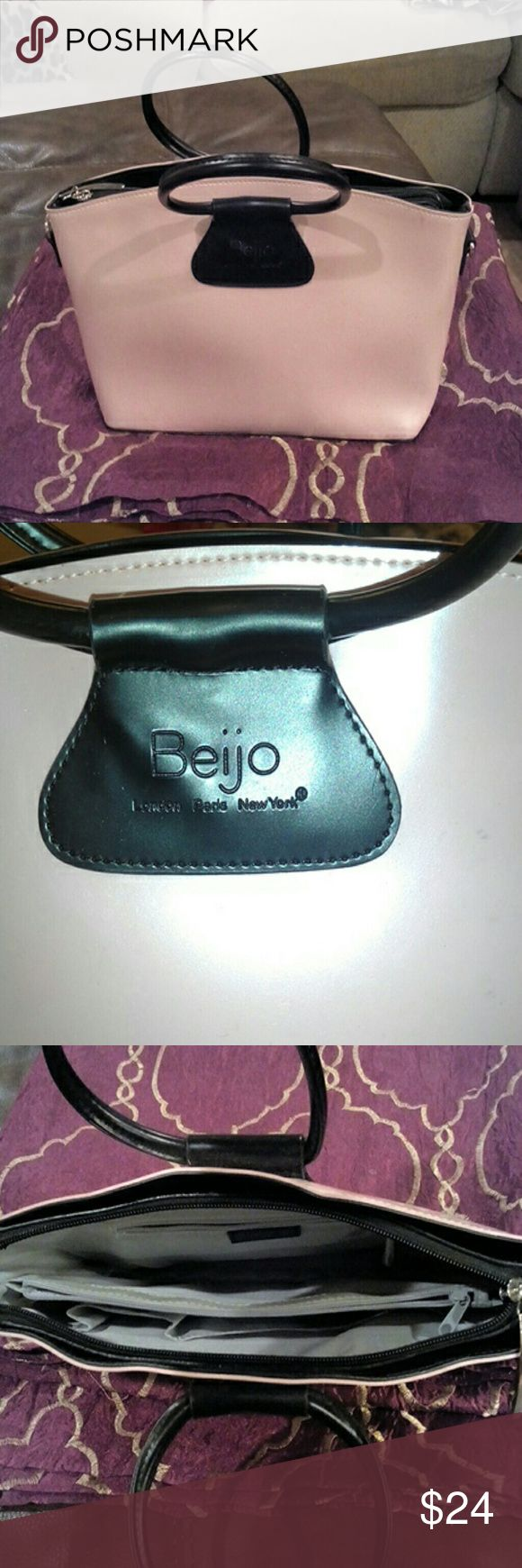 Beijo Handbag Light pin with black trim handles and bottom, with studs.  Interior in clean condition with large middle zippered pocket, side zippered pocket and organizer.  Some light blue ink smudge on lower front (pic 4). Beijo Bags Satchels