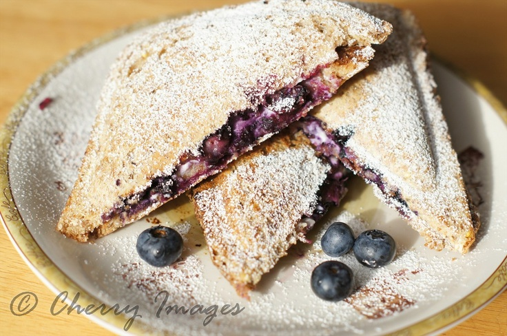 Blue berry panini sandwich. Brown bread, cream cheese and blue berries toasted in sandwich grill.