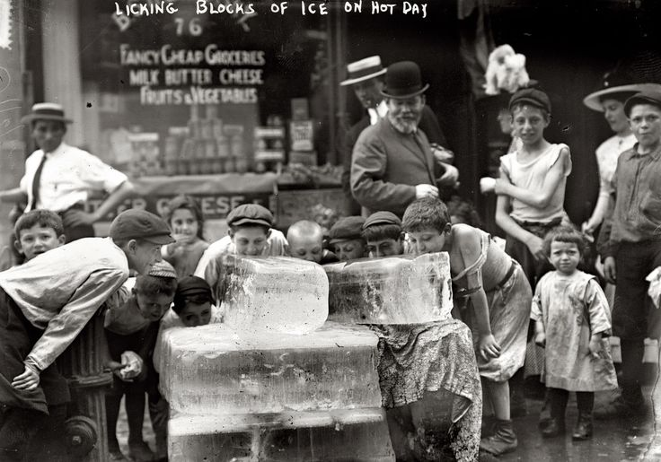 "Heat wave in New York. July 6, 1911. ""Licking blocks of ice on a hot day."""