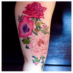 I don't necessarily like the tattoo but if I get flowers I want them to look soft like this with no outline. :)