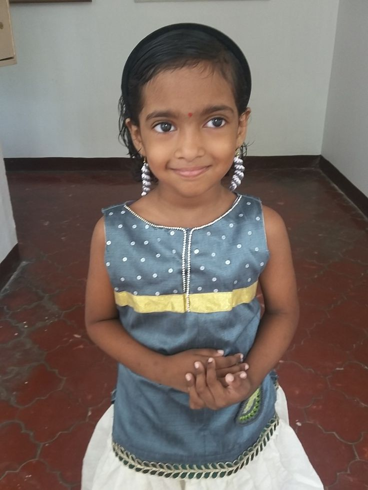 Crochet earring for my girl and dress with crochet applique.(Occassion: school onam celebration)