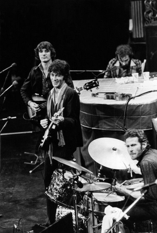 The Band: Robbie Robertson and Rick Danko (RIP) are standing. Richard Manuel (RIP) is seated at the piano. Drummer and vocalist Levon Helm (RIP) is in the foreground. Garth Hudson is not shown.