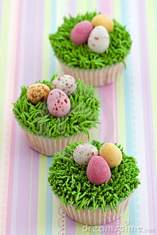 Easter Egg Nest Cupcake - These are my all time favorites. The large cupcake is topped with green tinted frosting (applied with grass Wilton Tip # 233) and Speckled Egg Shaped Malt Balls or M&Ms.