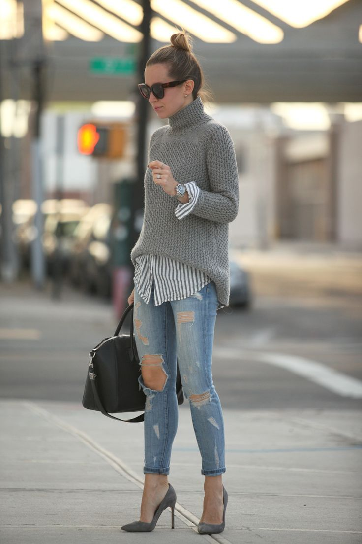 This combo of a grey knit turtleneck and blue distressed skinny jeans will attract attention for all the right reasons. A pair of charcoal suede pumps will seamlessly integrate within a variety of outfits.  Shop this look for $138:  http://lookastic.com/women/looks/sunglasses-turtleneck-watch-dress-shirt-skinny-jeans-satchel-bag-pumps/7644  — Dark Brown Sunglasses  — Grey Knit Turtleneck  — Silver Watch  — Charcoal Vertical Striped Dress Shirt  — Blue Ripped Skinny Jeans  — Black Leather ...
