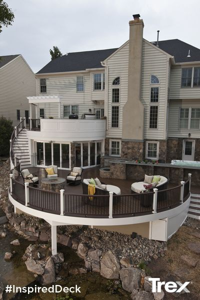 Elevated outdoor living at its finest featuring durable Trex Elevations, Trex Transcend Spiced Rum and Vintage Lantern decking and Trex Transcend railing. Find more inspirational outdoor living spaces at Trex.com. #InspiredDeck #sweepstakes