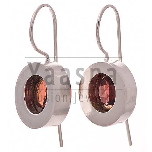 Deep Rose Oval Sterling Silver Earrings    - Hallmarked Sterling Silver  - Handmade  - Hand cut garnet gemstone in centre    Available at http://www.yaasna.com/earrings/stone-silver/deep-rose-oval-sterling-silver-earrings.html