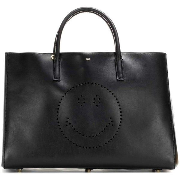 Anya Hindmarch Ebury Maxi Wink Leather Shopper ($960) ❤ liked on Polyvore featuring bags, handbags, tote bags, black, genuine leather handbags, anya hindmarch tote, genuine leather purse, genuine leather tote bag and leather shopper tote bag