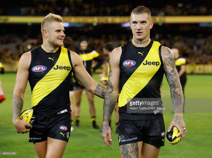 Brandon Ellis of the Tigers (left) celebrates with Dustin Martin of the Tigers during the 2017 AFL round 02 match between the Richmond Tigers and the Collingwood Magpies at the Melbourne Cricket Ground on March 30, 2017 in Melbourne, Australia.
