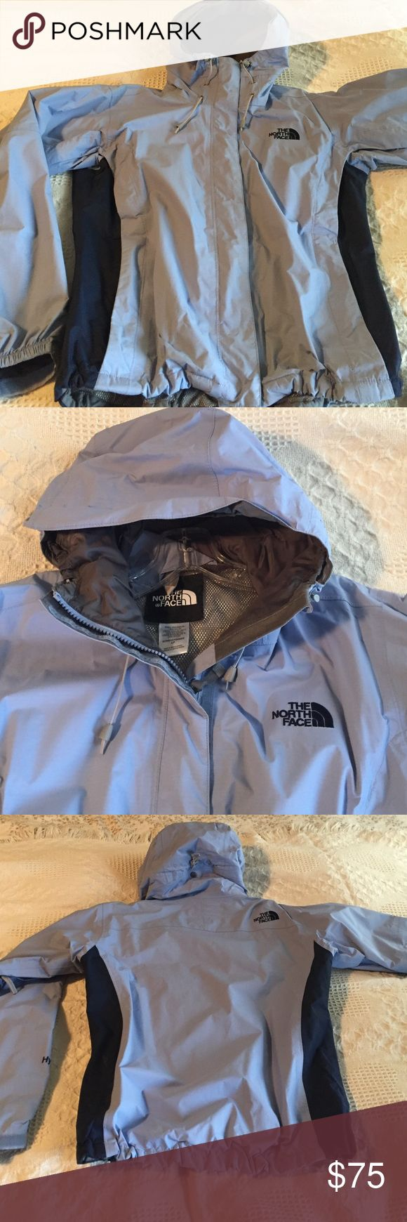 North Face Jacket Women's North Face lightweight shell rain resistant jacket. Beautiful limited edition periwinkle light blue color with navy color panels down sides under arms and for logo. This jacket features the North Face standard shell zipper meaning this jacket can be worn alone or zipped into a heavier style jacket for added warmth. Like new condition, no signs of wear. North Face Jackets & Coats Utility Jackets